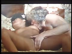 Horny brunette enjoys sucking a huge pole as she slides a toy into her cunt